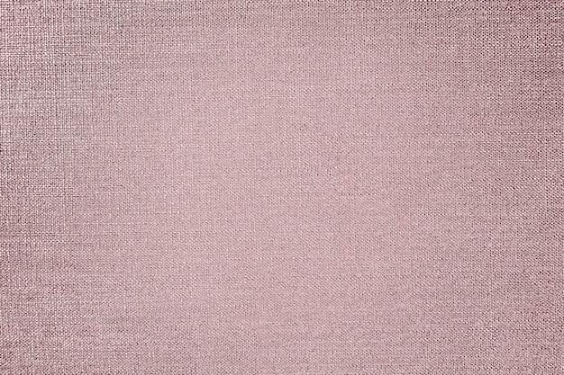 Fond texturé de tissu de coton d'or rose