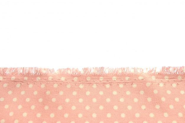 Fond et texture de tissu de coton poussiéreux à pois beige avec des franges le long du bord