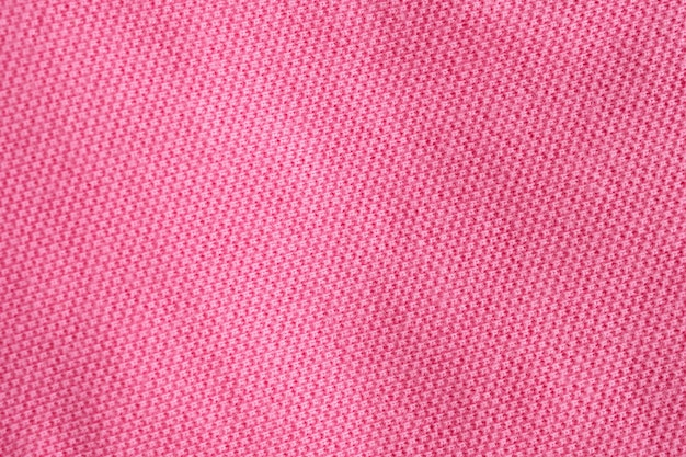 Fond de texture de tissu de coton rose closeup