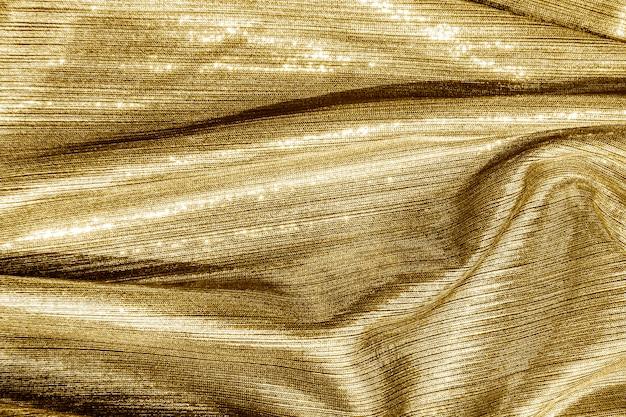 Fond texturé en tissu doré soyeux