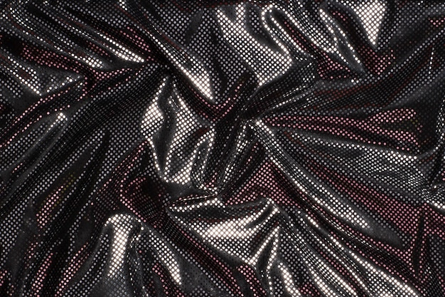 Fond de texture de tissu gris noir métallique à pois argent