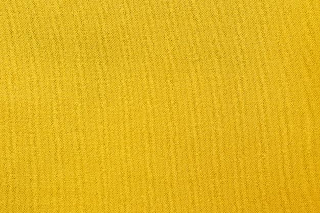 Fond de texture de tissu jaune
