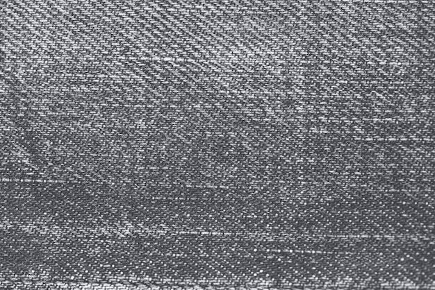 Fond texturé en tissu jeans gris