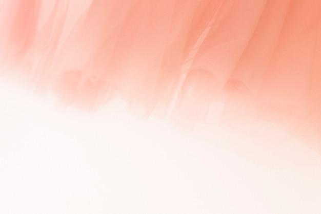 Fond de texture de tissu mousseline pêche pour bannière de blog