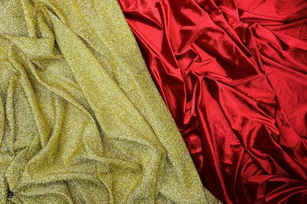 Fond de texture de tissu or et rouge