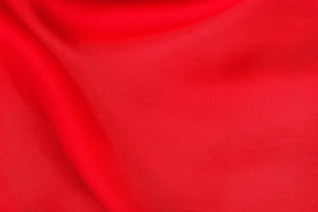 Fond de texture de tissu rouge, motif froissé de soie ou de lin.