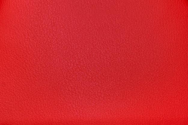Fond de texture de tissu rouge vif