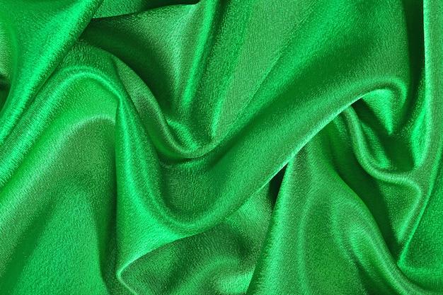 Fond de texture de tissu satiné vert naturel