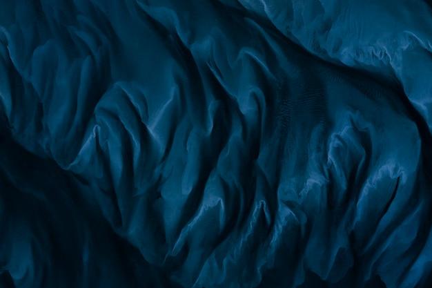 Fond texturé en tissu de soie bleu marine