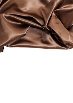 Fond de texture de tissu en soie marron