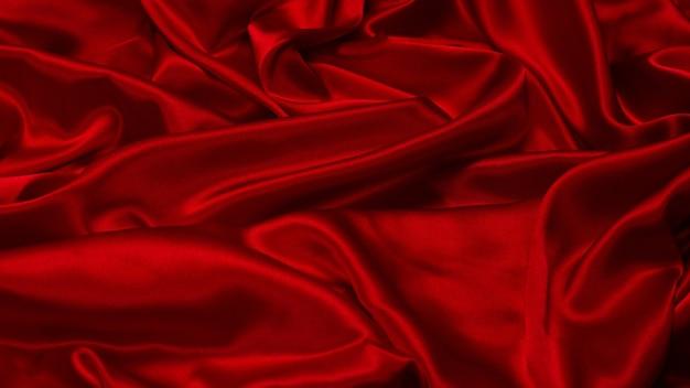 Fond de texture de tissu de soie rouge riche et luxueux. vue de dessus.