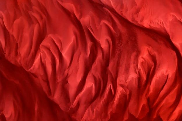 Fond texturé en tissu de soie rouge