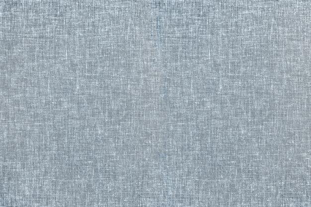 Fond texturé en tissu de tapis gris