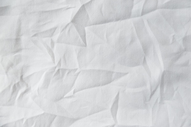 Fond de texture de tissu de toile froissée blanche
