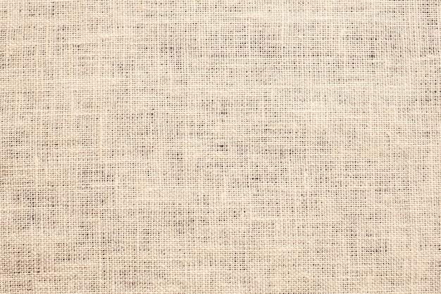 Fond de texture de tissu de toile marron clair.