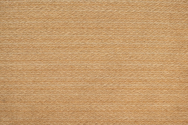 Fond de texture de tissu de toile de tissage marron clair.