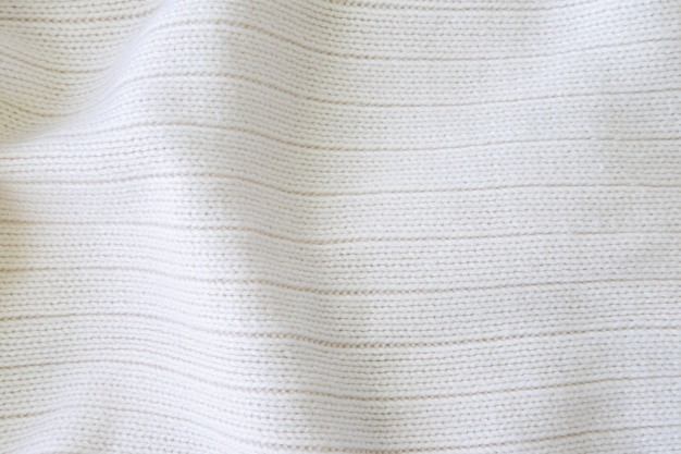 Fond de texture de tissu en tricot blanc.