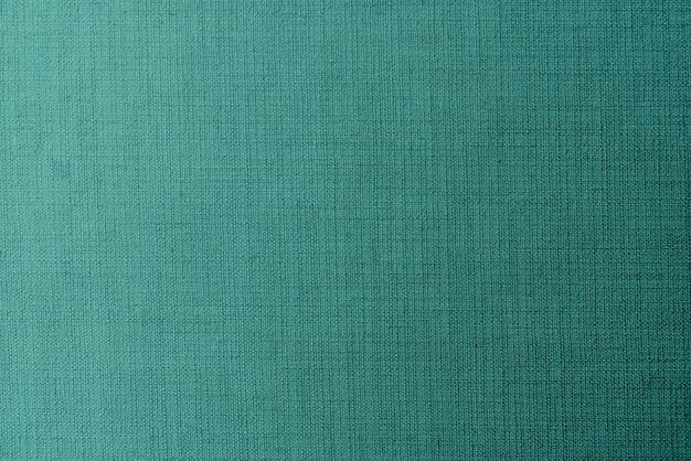 Fond texturé en tissu vert uni