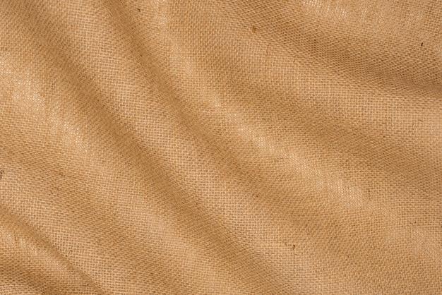 Fond de texture de toile de jute. draperie de toile de jute en lin se bouchent.