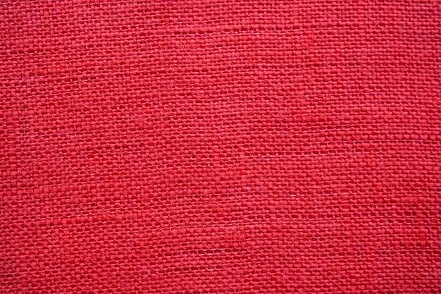 Fond de texture de toile de lin de couleur rouge