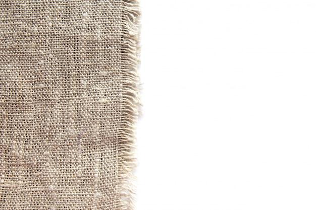 Fond et texture de toile de lin grossière grise avec un tissage serré et une frange le long du bord
