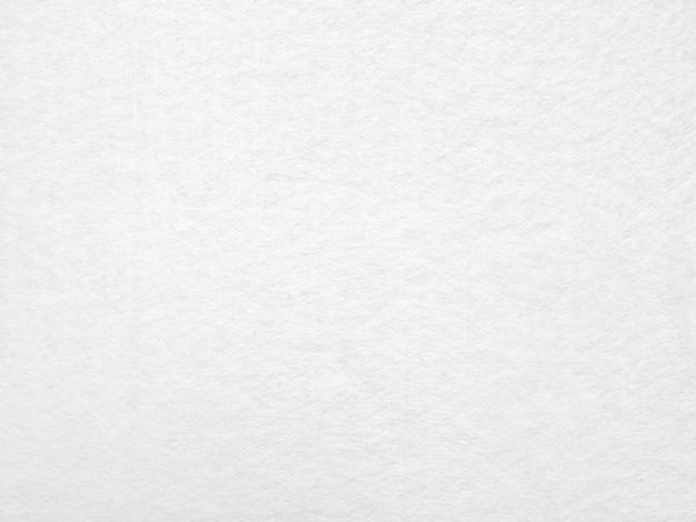 Fond de texture de toile en papier blanc pour un fond de conception ou un design de superposition