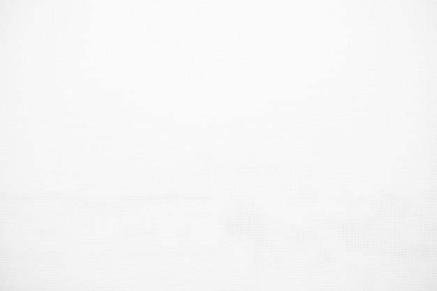 Fond de texture de toile de tissu blanc pour la conception de fond noir ou de superposition