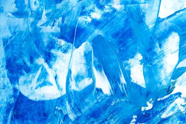 Fond texturé de trait de pinceau bleu