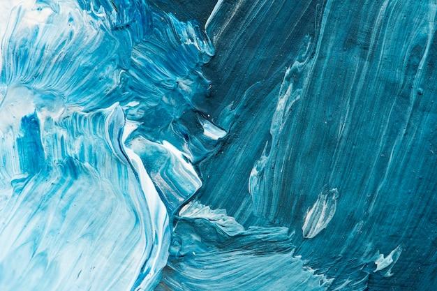 Fond texturé de traits de peinture à l'huile bleue