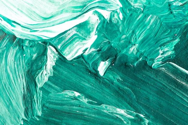 Fond texturé de traits de peinture à l'huile verte