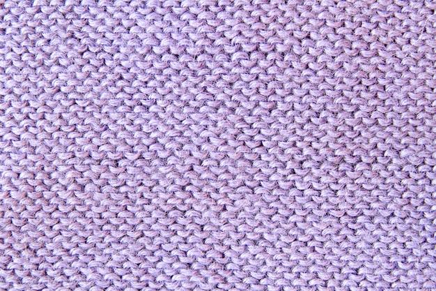 Fond texturé tricoté violet ou violet. fermer