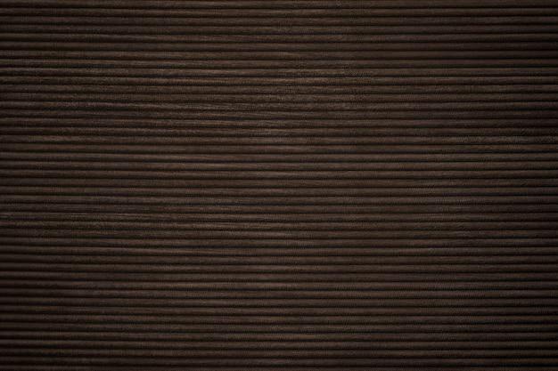 Fond texturé en velours côtelé marron foncé