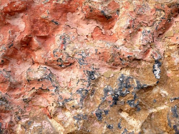 Fond et texture vieillis le mur de l'ancien bâtiment ciment et peinture ancienne