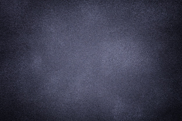Fond de tissu en daim gris et bleu foncé agrandi.