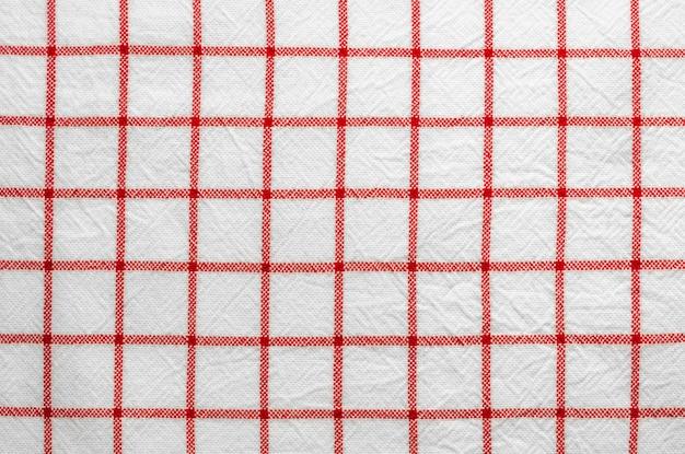 Fond de tissu écossais motifs rouges et blancs.