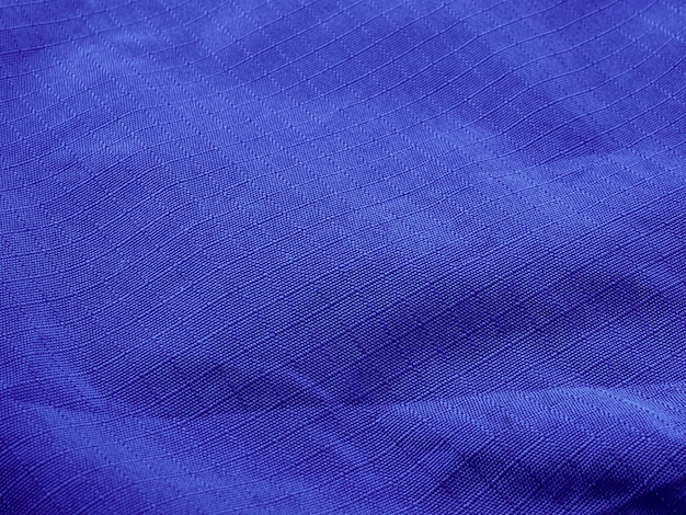 Fond de tissu froissé abstrait violet avec espace de copie, vue d'en haut
