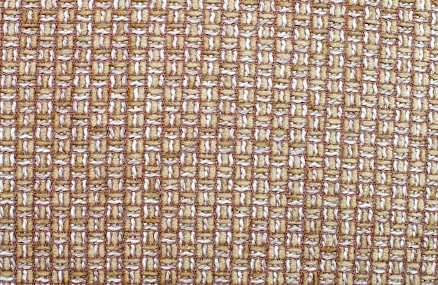 Fond de tissu en osier marron clair. texture de tissu naturel