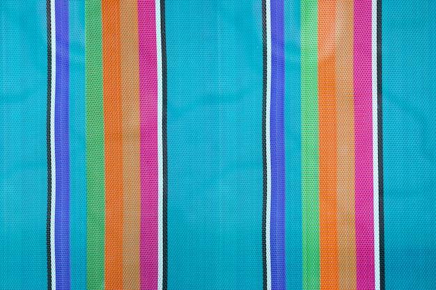 Fond de tissu rayé coloré, texture de la chaise de plage pliante