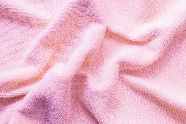 Fond de tissu serviette rose froissé