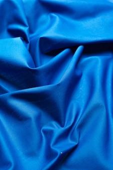 Fond de tissu en soie bleu