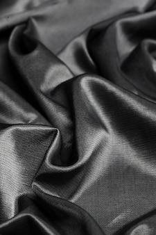 Fond de tissu de soie noire