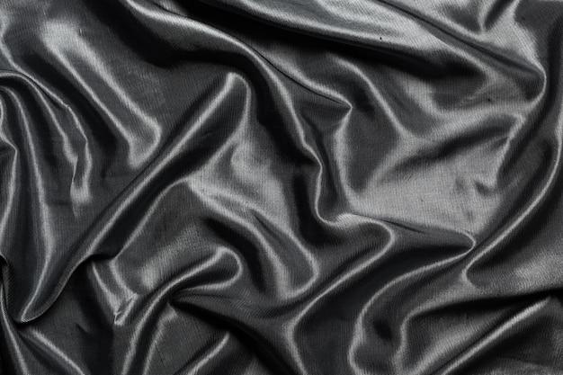 Fond de tissu en soie noire