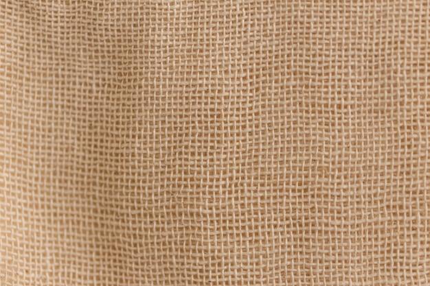 Fond de tissu de texture de coton de coton de calicot non blanchi.