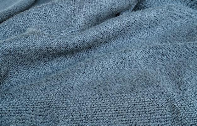Fond de tissu veste bleu froissé closeup