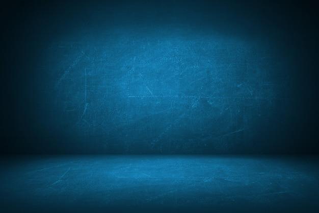 Fond de toile de fond studio bleu grunge