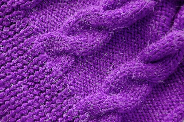 Fond tricoté. texture tricotée. tricot de laine.