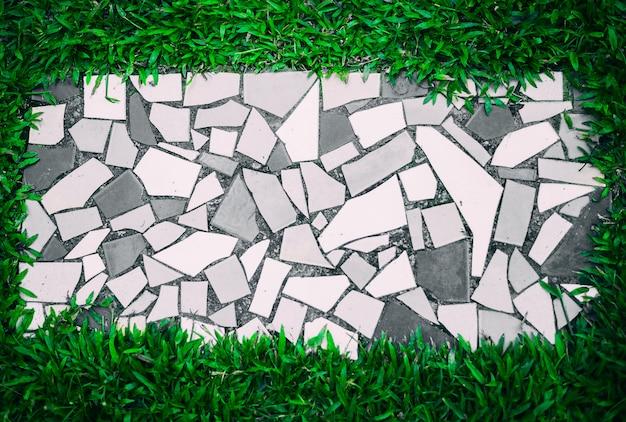 Fond de tuile vue de dessus avec de l'herbe