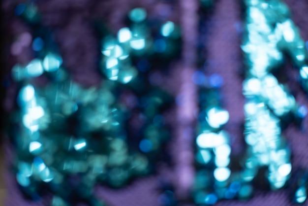 Fond turquoise brillant autour des paillettes comme une queue de sirène
