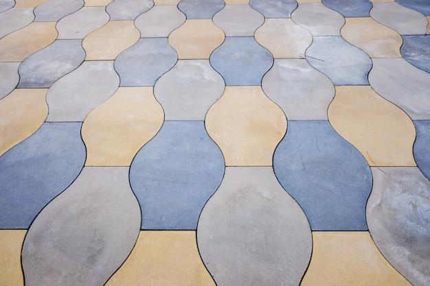 Fond urbain, sol avec des carreaux de formes arrondies et de couleurs terre.