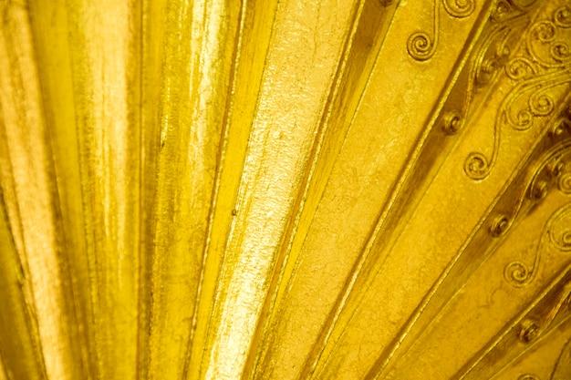 Fond de ventilateur pliant en or